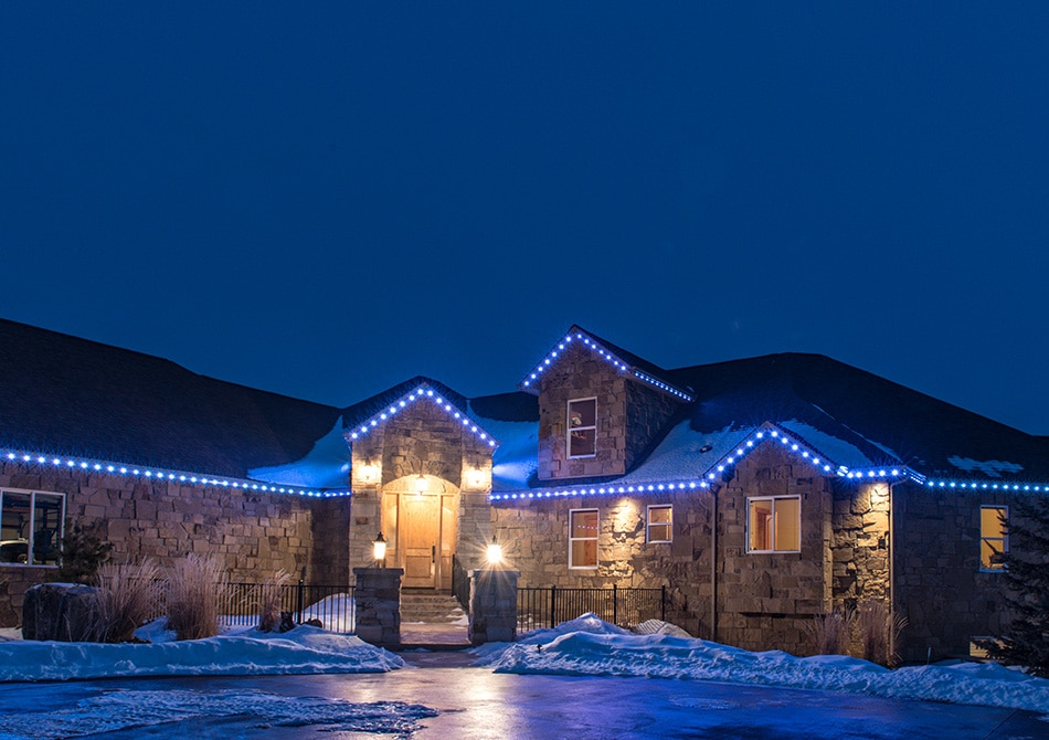 Blue permanent LED holiday lights shine brightly on this home.