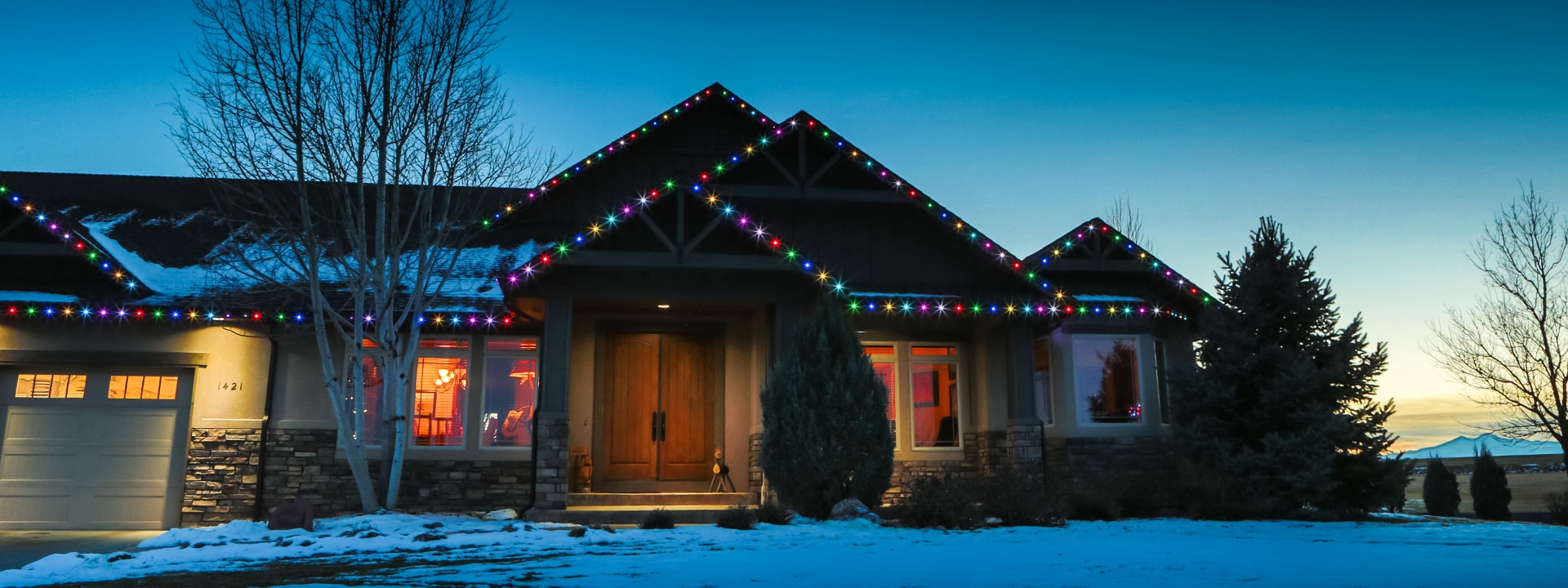 Color-changing permanent Christmas lights by Oelo.