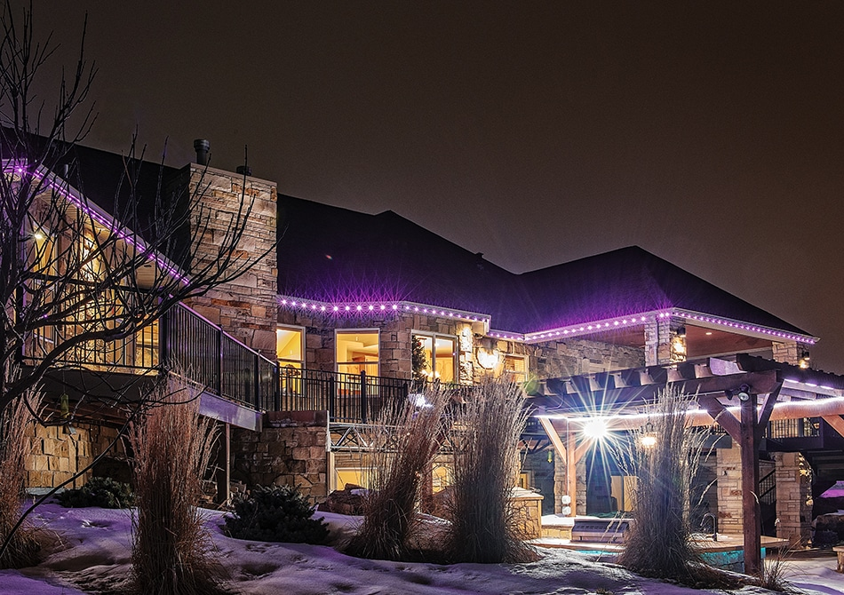 color changing permanent led holiday lights surround this home